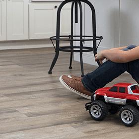 Boy and Truck on Phenix floor | Roberts Carpet & Fine Floors
